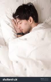 man lying asleep cozy white pillow stock photo 614861624