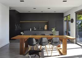 sleek black kitchen by owner architect with black porcelain slab