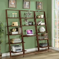 large wooden leaning ladder wall shelves laptop desk and wishbone