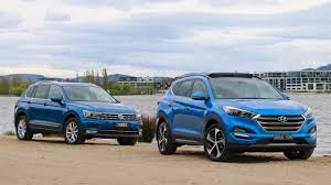 volkswagen blue hyundai tucson highlander vs volkswagen tiguan highline comparison