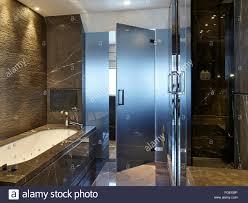 glass door bar interior dark marble bathroom with bath and glass door tudor hall