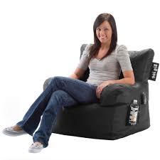 teens room teen relaxing in green bean bag chair stock image