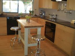 kitchen island design tips midcityeast round metal stools and small kitchen island table near long wooden counter in minimalist kitchen