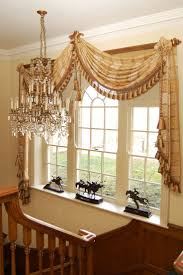 best 20 window scarf ideas on pinterest curtain scarf ideas one large fringed scarf draped on each corner of a wooden decorator pole topped with rosettes