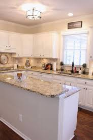 granite countertops kitchen with white cabinets lighting flooring