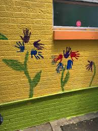 fundraiser by brandi cottingham food bank wall mural project hand prints become flower petals as we break down what seems complex into using our authentic tools we have many more bricks to paint