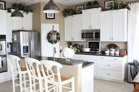 greenery above kitchen cabinets ideas in white painted cabinets