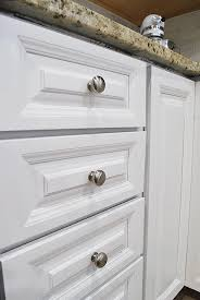 what finish paint for kitchen cabinets how to paint your kitchen cabinets for a smooth painted finish 11