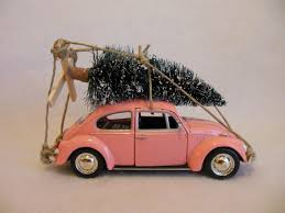 classic pink vw beetle bug with tree car