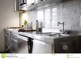 modern stainless steel kitchen modern kitchen with stainless steel appliances stock photos