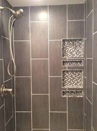 Large Sliced Sea Green Pebble Tile Shower Floor And Niche House - Shower wall tile designs