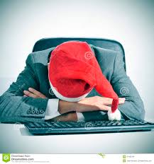 man sleeping in the office after a christmas party stock photo