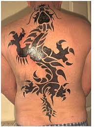 tribal tribe dragon small and large back piece tattoo image