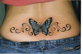 blue butterfly swirl on back tattoomagz