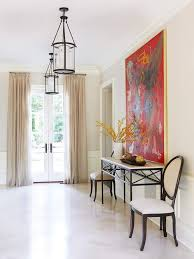 Foyer Artwork Ideas A Clean Neutral Background Lets A Large Bold Piece Of Artwork