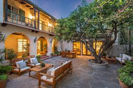 marlene dietrich s glamorous spanish style home asks 6 5m curbed la outdoor courtyard in the evening