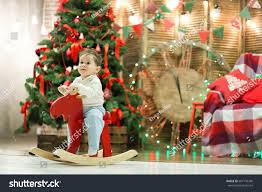 happy cute small boy riding wooden stock photo 697176349