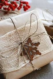 rustic christmas wrapping paper brown wrap with rustic ribbon twine snowflake trim