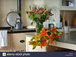 Vase Uk Lilies On A Country Kitchen Table With Other Cut Flowers In A Vase