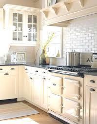 white kitchen cabinets with white backsplash combine cabinets and aga with white backsplash