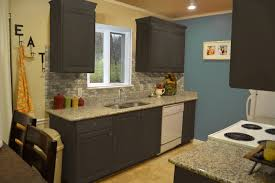 black island kitchen with granite countertop and marble flooring