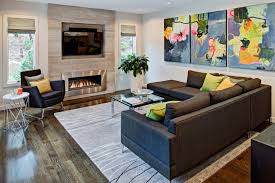 family room with sectional and fireplace interior design marble side table with stainless steel fireplace