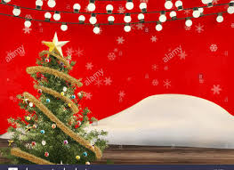 artificial tree with lights and ornaments stock photo