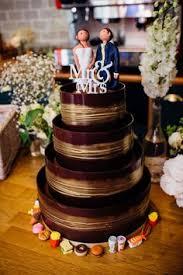 shimmering hoop chocolate wedding cake dark u0026 gold gold cake