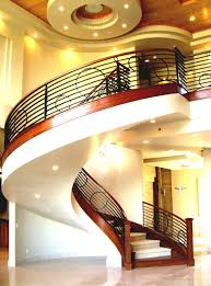 interior beautiful spiral staircase in large luxury home stock