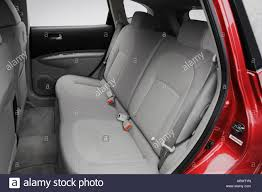 Nissan Rogue 2008 - 2008 nissan rogue s in red rear seats stock photo royalty free