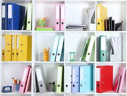 white office shelves with folders and different stationery close