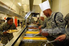 photos et images de us soldiers acknowledge thanksgiving day at