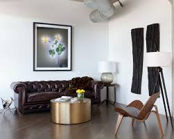 furniture bachelor living room with dark brown tufted leather sofa