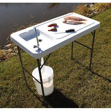 guide gear folding fish game cleaning table with sink faucet containment groove around the edge keeps fillets from slipping overboard