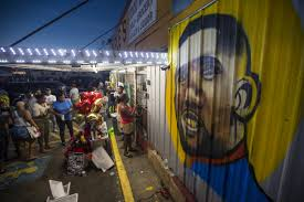 employers need to discuss the police shootings of black people protesters gather in front of a mural painted on the wall of the convenience store where