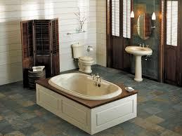 rustic design with small cream wood bathub on grey tile floor