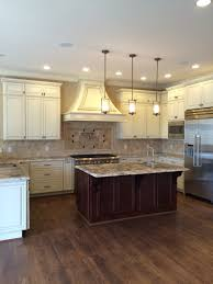 Antique White Cabinets With White Appliances by Glazed Antique White Perimeter Cabinetry Cherry Island Cabinets