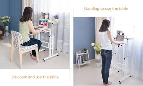 you can standing or sit down to use it standing to use the table can release your spine pressure more conducive to good health