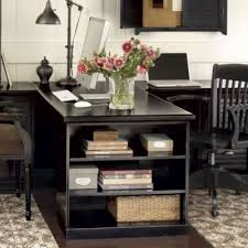 what is a desk return two desks with a shared side that ends with a bookcase as a person