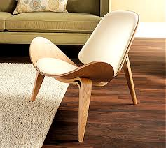 Shell Chair This Chair Has Threelegged Base The Chair Is - Hans wegner chair designs
