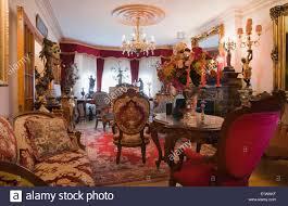 antique furniture furnishings adorn a living room inside a