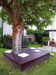 love this deck built around a clump of trees the deck could also