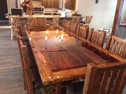 made custom built reclaimed barn wood dinning room table and