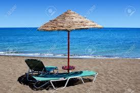 Beach Sun Umbrella An Umbrella And Sun Bathing Chairs On The Black Beach Of Perissa
