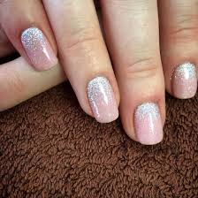 use a glitter polish to hide the bare base of your grown out mani