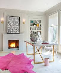 pink cowhide rug with brass and marble desk contemporary