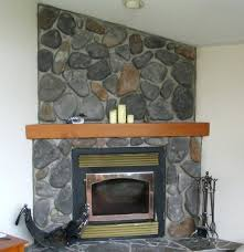 electric fireplace with mantel and multicolor stone facade logs