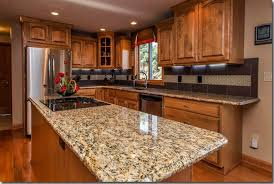 maple cabinets with granite countertops giallo ornamental granite countertops with oak cabinets giallo