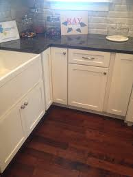 Blue Granite Floor Tiles by Blue Pearl Granite Counter With White Farmhouse Sink And White