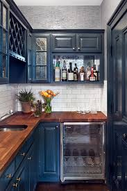 small kitchens can handle deep blue cabinets when the walls are